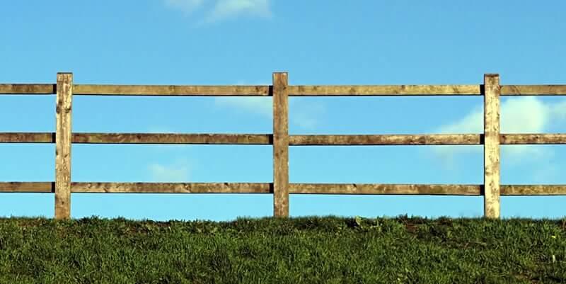split rail fence on grass