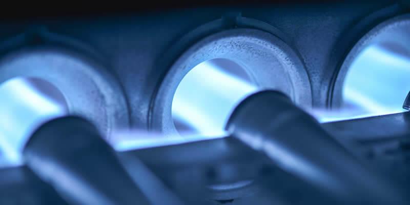 new gas furnace burner glowing