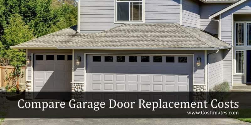 new garage doors on gray house